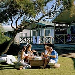 Holiday Parks Cabin Family Front Blue Sitting Together- Caravan Camping NSW