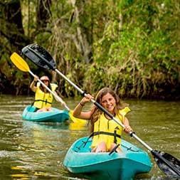 Holiday Parks Girls Kayaking River- Caravan Camping NSW