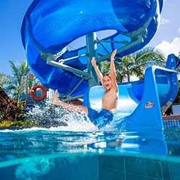 Holiday Parks Boy Splashing in Pool Water Park- Caravan Camping NSW