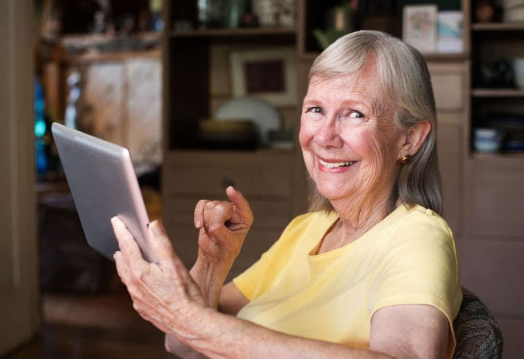 over 55 women using a tablet device
