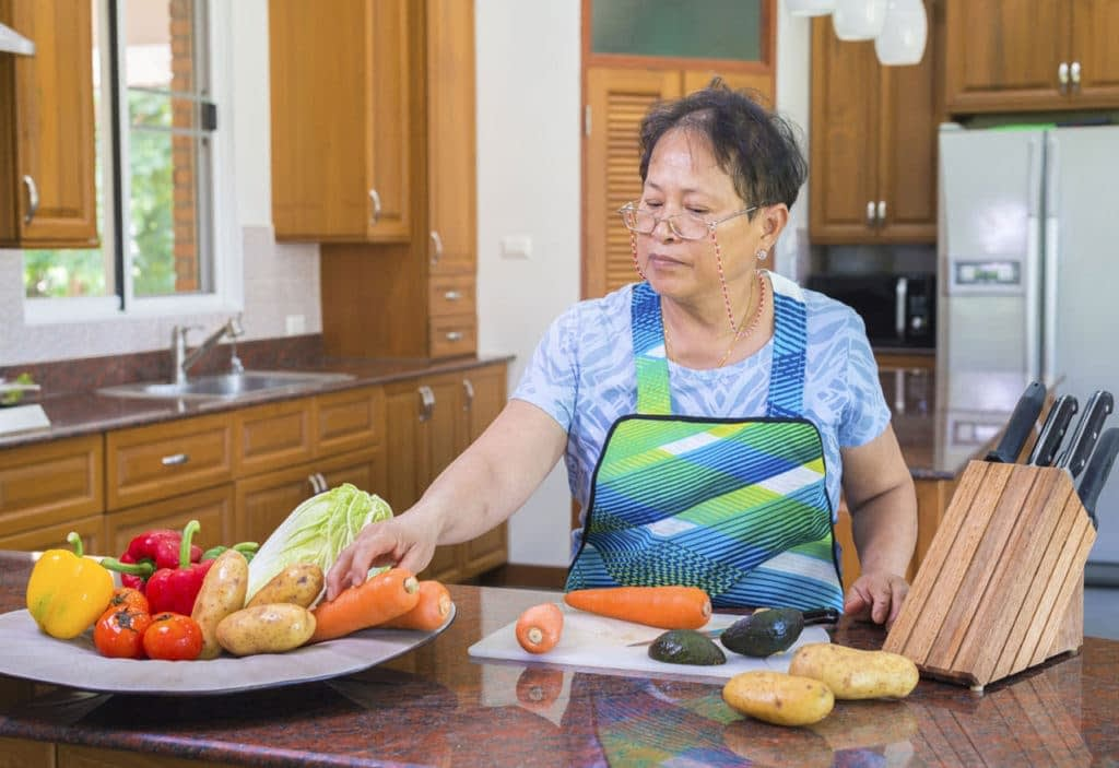 women in a retirement village cooking