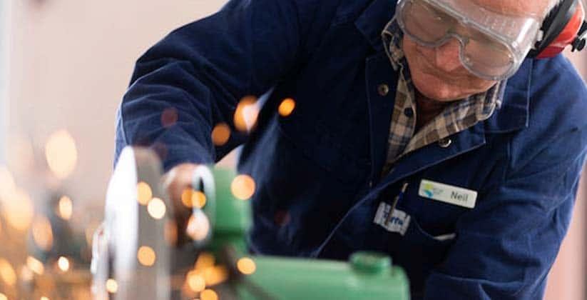 Senior man using hand tools